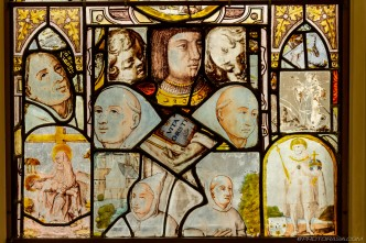 stained glass patchwork of people and faces