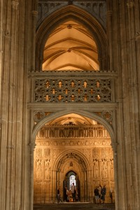 tudor arch revealing choir screen and entrance to choir stalls and presbytery