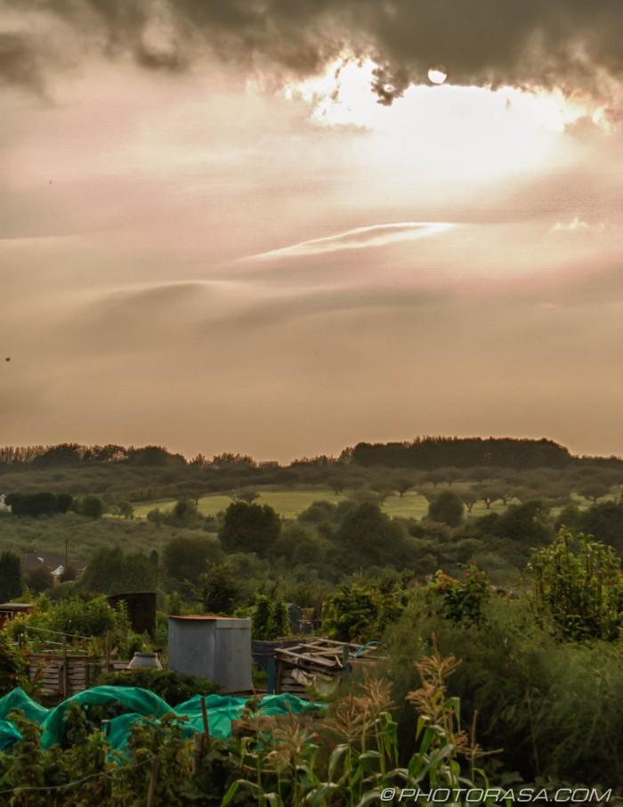 sun over cloudy haze kentish fields