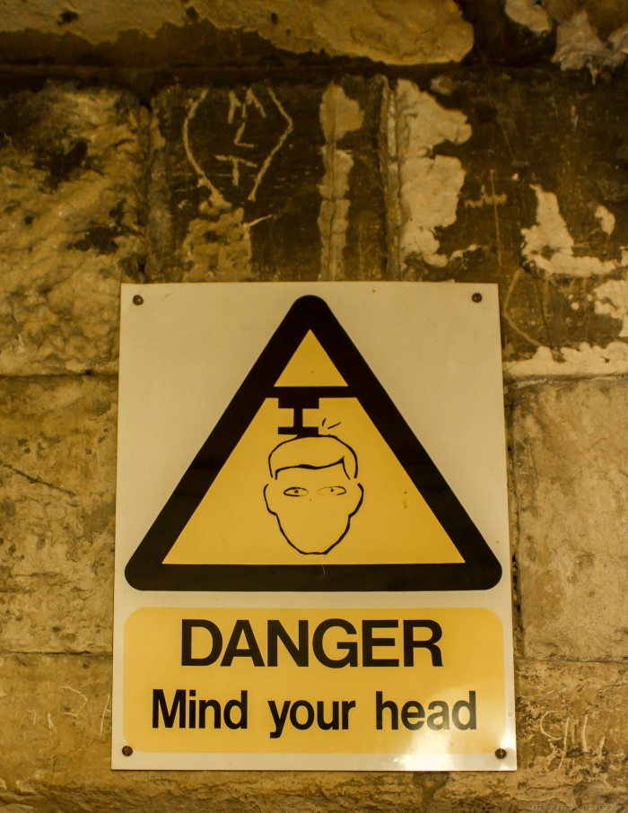 danger mind your head warning sign