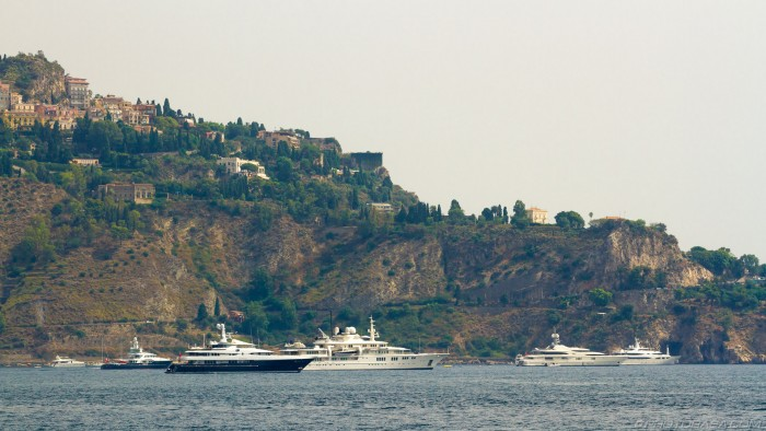 group of super yachts near giardini naxos