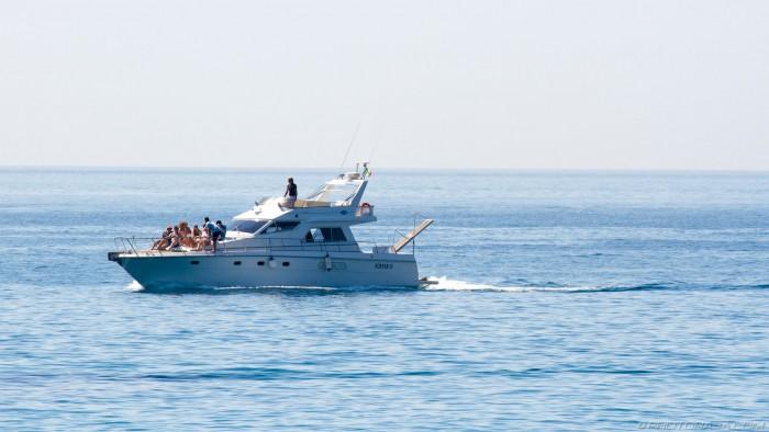 speeding yacht full of people